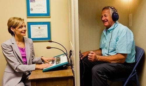 audiologist conducting a hearing test