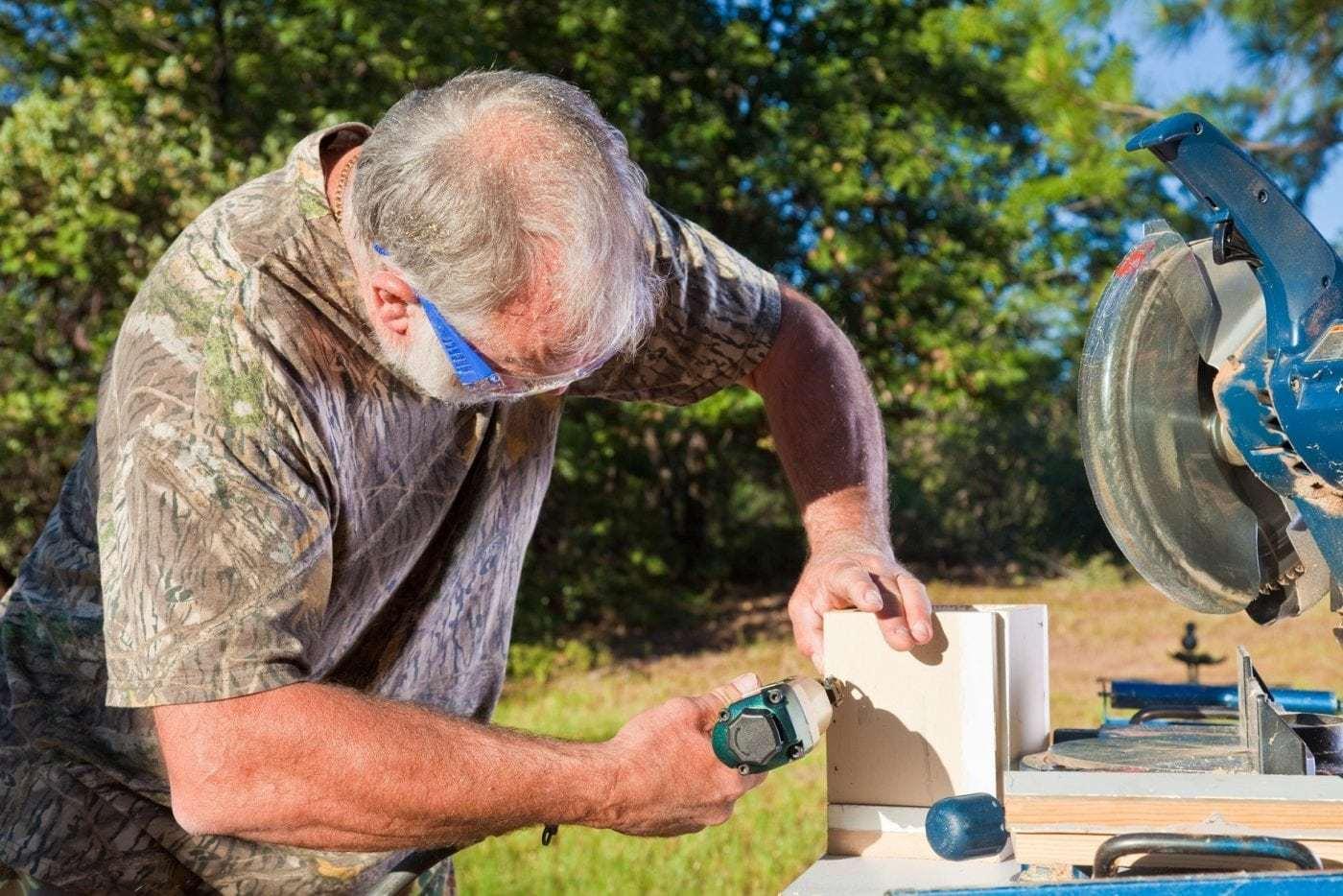 Man Uses a Nail Gun
