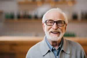 hearing aids elderly man