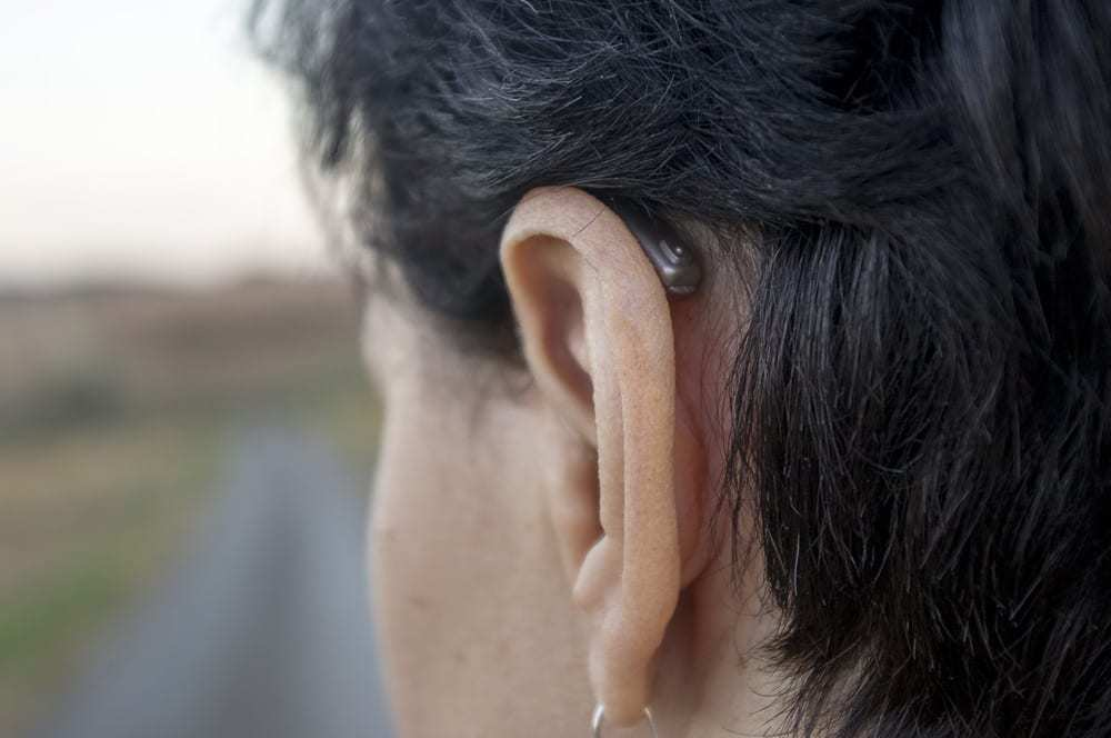Close-up of ear with invisible hearing aid